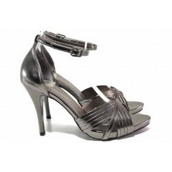 Стилни дамски сандали в сребрист цвят, абитуриентски, висок ток, каишка около глезена за повече стабилност / ФА 030 т.сребро / MES.BG